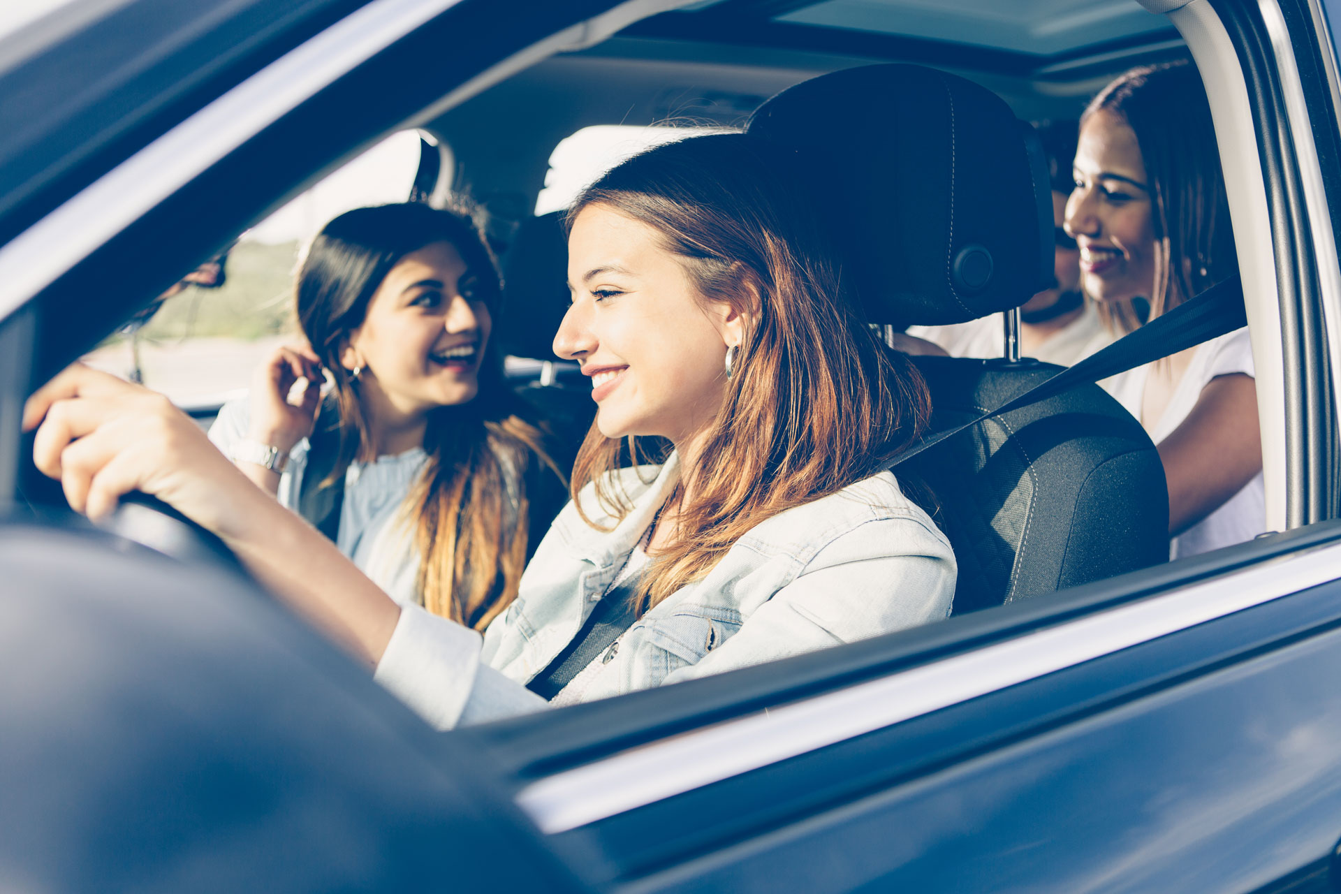 teen girls driving in car